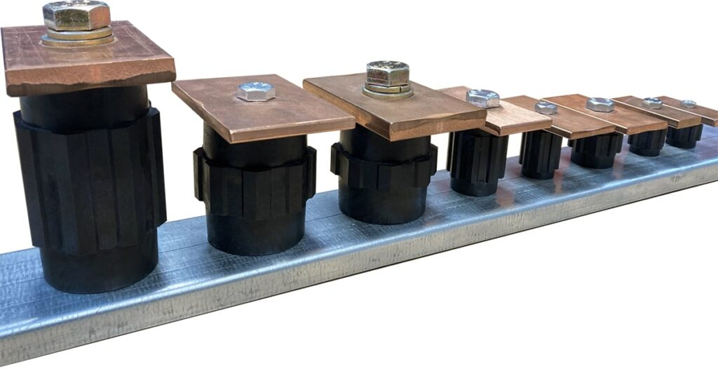 A range of low voltage standoff insulator of various height and width sizes affixed to busbars