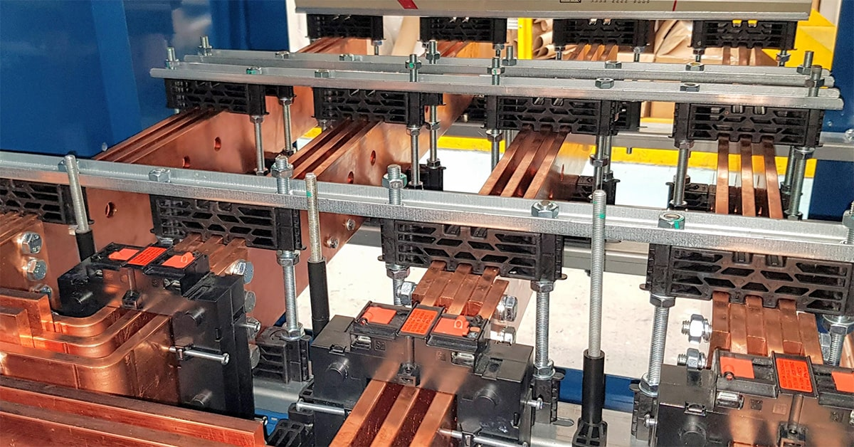Busbar Supports clamped around busbars in Low Voltage Switchgear and controlgear assembly